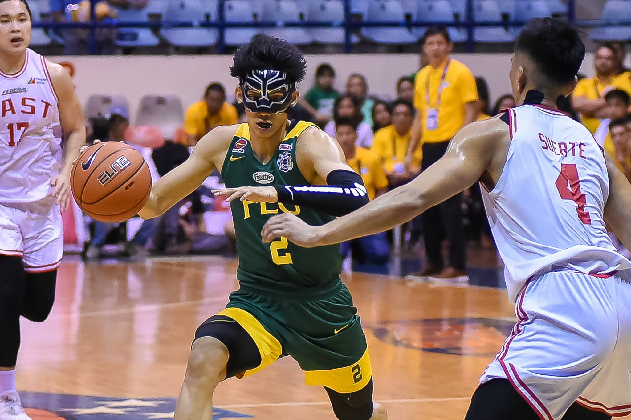 FEU hammers UE for 24-point win to book semis seat
